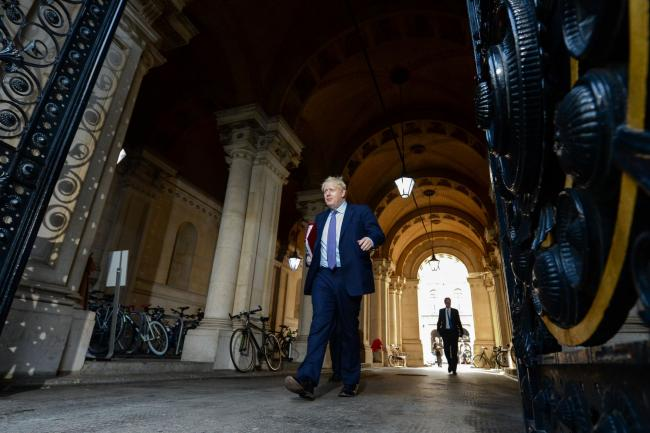 © Bloomberg. Boris Johnson departs from a weekly meeting of cabinet ministers in London on Oct. 20. Photographer: Chris J. Ratcliffe/Bloomberg