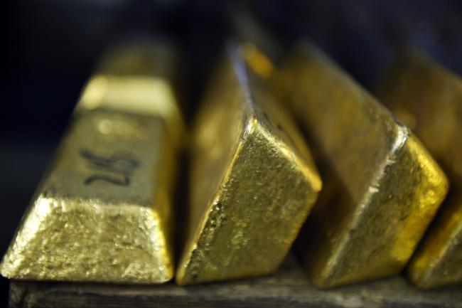 © Bloomberg. Gold bars sit in a vault at the Perth Mint Refinery, operated by Gold Corp., in Perth, Australia, on Thursday, Aug. 9, 2018. Demand for coins and minted bars was a little sluggish over the past year as Donald Trump's earlier win in the presidential poll prompted investors to divert funds into stocks, bonds and property, said Perth Mint's Chief Executive Officer Richard Hayes on Aug. 8. Photographer: Carla Gottgens/Bloomberg