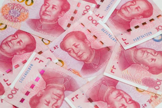 © Bloomberg. Chinese one-hundred yuan banknotes are arranged for a photograph in Hong Kong, China, on Thursday, April 23, 2020. The People's Bank of China (PBOC) has cut short- and medium-term rates recently on top of liquidity injections, loan rollovers and easier regulatory rules. Photographer: Paul Yeung/Bloomberg