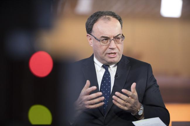 © Bloomberg. Andrew Bailey, chief executive officer of Financial Conduct Authority (FCA), gestures while speaking during a Bloomberg Television interview in London, U.K., on Friday, Dec. 1, 2017. Bailey said the regulator won't get involved in the appointment of a new chief executive officer at London Stock Exchange Group Plc after Xavier Rolet left this week, as long as the process is
