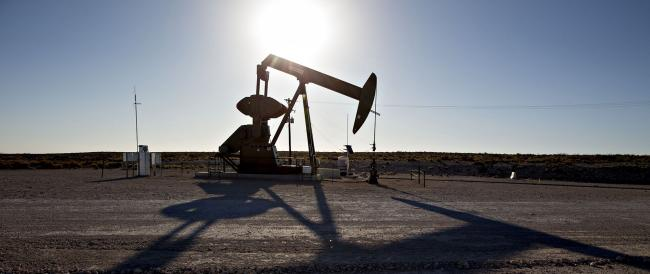 © Bloomberg. A pumpjack operates on an oil well in the Permian Basin near Orla, Texas. Photographer: Daniel Acker/Bloomberg