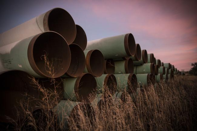 © Bloomberg. GASCOYNE, ND - OCTOBER 14: Miles of unused pipe, prepared for the proposed Keystone XL pipeline, sit in a lot on October 14, 2014 outside Gascoyne, North Dakota. (Photo by Andrew Burton/Getty Images) Photographer: Andrew Burton/Getty Images North America