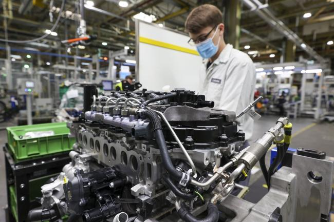 © Bloomberg. A worker wearing a protective face mask fixes parts to a 4 cylinder diesel motor engine on the production line at the Adam Opel AG automobile component factory in Kaiserslautern, Germany, on Tuesday, July 7, 2020. German industrial production rose less than analysts expected in May, underscoring the challenge faced by Europe's economy as it emerges from months-long coronavirus lockdowns.