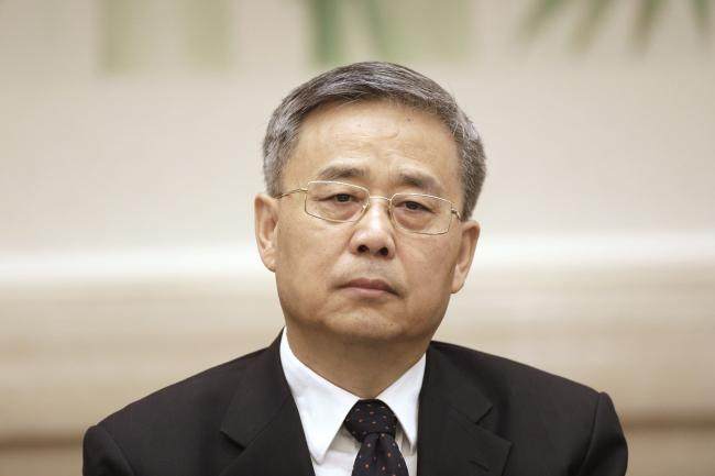 © Bloomberg. Guo Shuqing, chairman of the China Banking Regulatory Commission, attends a news conference at the Great Hall of the People during the 19th National Congress of the Communist Party of China in Beijing, China, on Thursday, Oct. 19, 2017. Communist Party leaders are gathering in Beijing this week to map policy for the next five years, with PresidentXi Jinpingtelling delegates that China is transitioning from a rapid growth model to one more focused on high-quality development.
