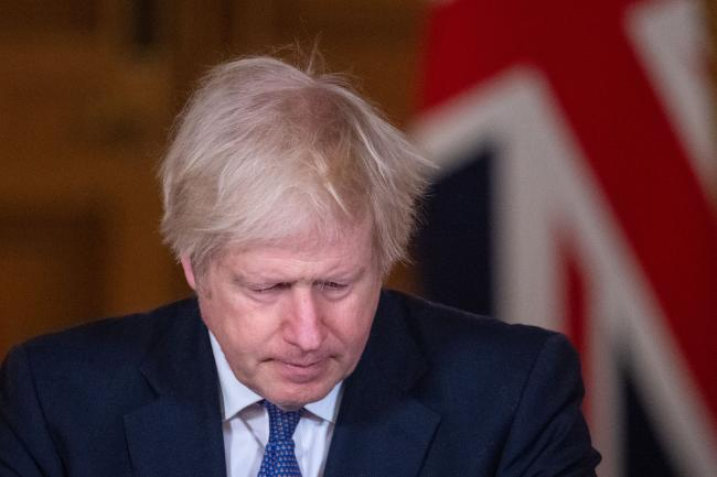 © Bloomberg. LONDON, ENGLAND - JANUARY 15: UK Prime Minister Boris Johnson looks down during a media briefing on coronavirus (COVID-19) at Downing Street on January 15, 2021 in London, England. (Photo by Dominic Lipinski - WPA Pool/Getty Images)