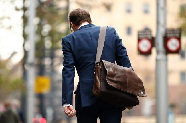 © Bloomberg. A commuter walks through the central business district of Sydney, Australia, on Monday, May 20, 2019. Prime Minister Scott Morrison's center-right government will command a parliamentary majority, the Australian Broadcasting Corp. projected Monday, fueling a stock market rally as investors welcomed his surprise victory in the weekend election. Prime Minister Scott Morrison's center-right government will command a parliamentary majority, the Australian Broadcasting Corp. projected Monday, fueling a stock market rally as investors welcomed his surprise victory in the weekend election. Photographer: Brendon Thorne/Bloomberg