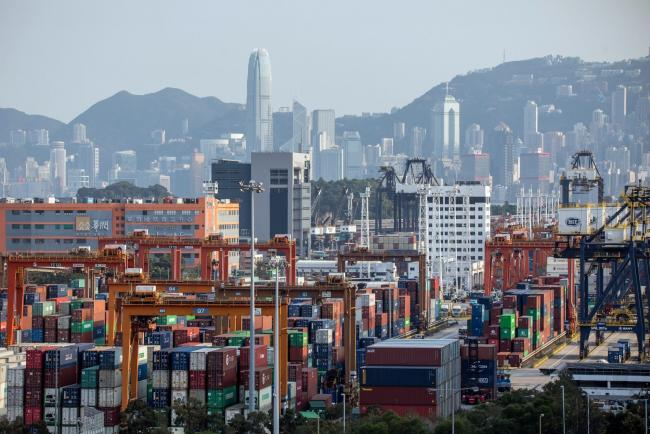 © Bloomberg. Gantry cranes stand as containers sit stacked at the Kwai Tsing Container Terminal in Hong Kong, China, on Thursday, Feb. 20, 2020. Hong Kong's container throughput fell 20.4% in January from a year ago according to preliminary figures posted on the Port Development Council's web site.