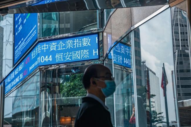 Hong Kong Stocks Surge Into a Bull Market in Win for Government